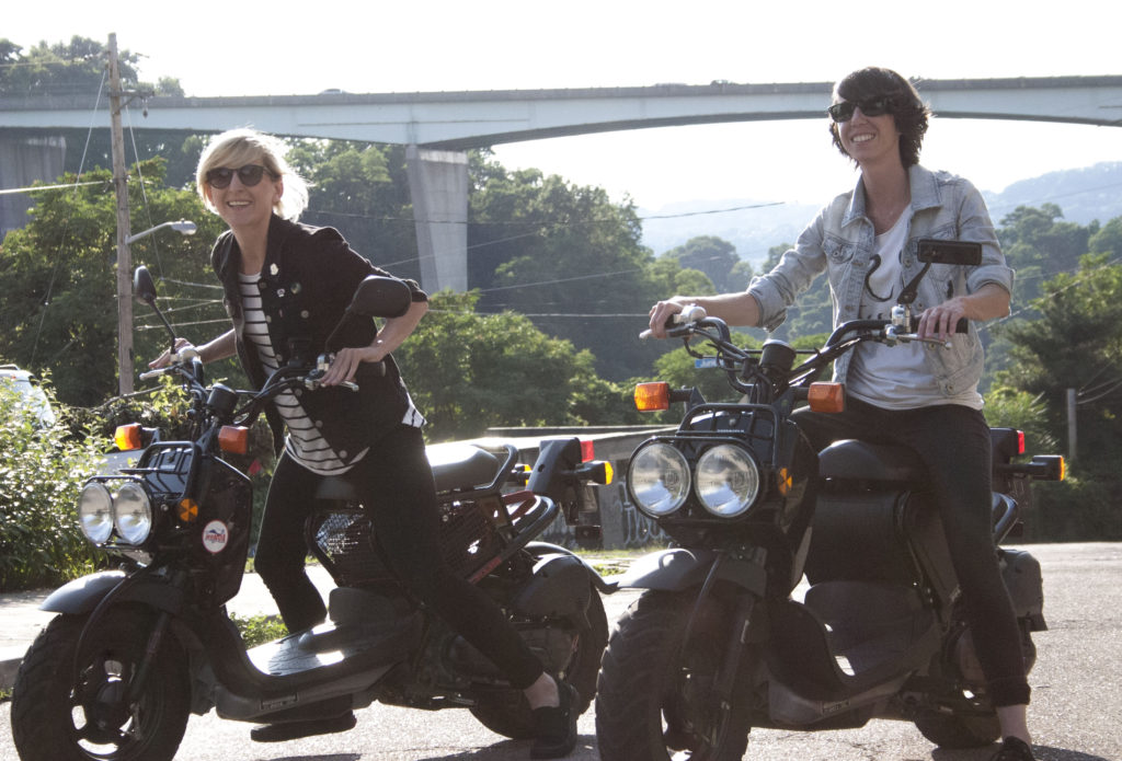 Vanessa Veltre, left, and Carrie Battle on their Honda Ruckuses in Bloomfield. Photo by Fred Blauth.